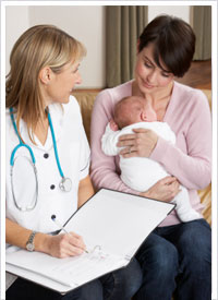 neonatal nurse with baby