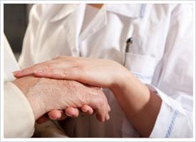 gerontology nurse holding elderly hand