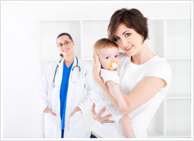 pediatric nurse standing with mother and child