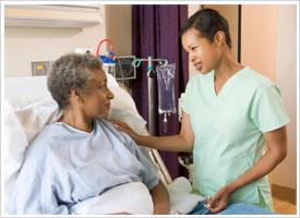 women's health nurse with patient