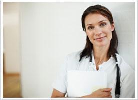 certified nurse holding folders