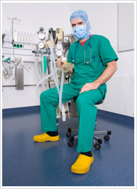 anesthetist with anesthetic machine