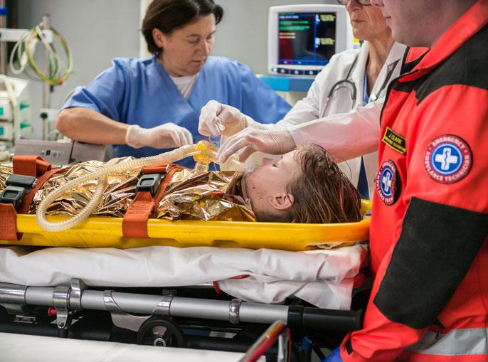 nurse oxygen mask young patient