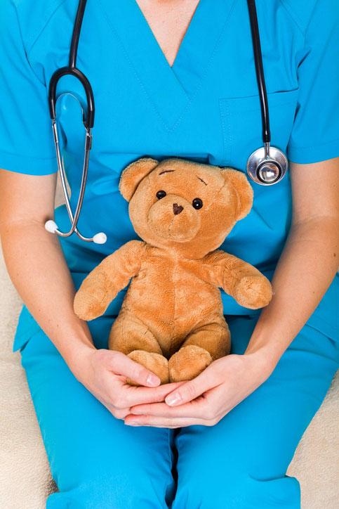 pediatric nurse holding teddy bear