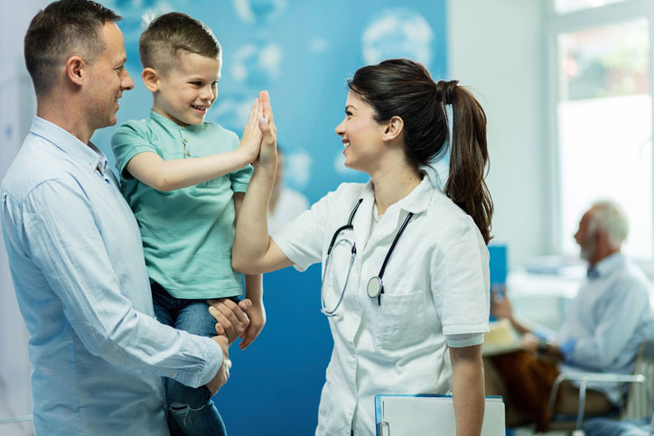 pediatric nurse with young patient