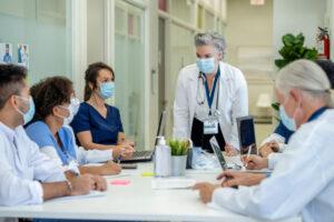 nurse admin running meeting